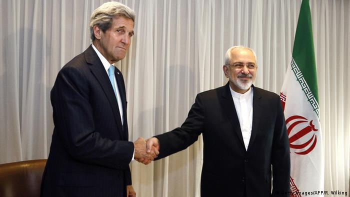Kerry and Zarif shake hands at the talks for the JCPOA