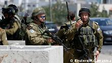 Israeli soldiers gather at scene of a stabbing attack near Arroub refugee camp near the West Bank city of Hebron July 18, 2016. REUTERS/Mussa Qawasma Reuters/M.Qawasma