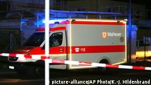 An ambulance stands at a road block in Wuerzburg, southern Germany, Monday evening July 18, 2016. A man attacked people in a train and injured several of them. (Karl-Josef Hildenbrand/dpa via AP) Copyright: picture-alliance/AP Photo/K.-J. Hildenbrand