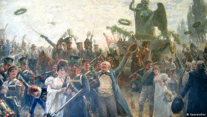 Триумфальное возвращение В 1814 году после разгрома войск Наполеона коалицией, во главе которой стояли Россия и Пруссия, квадригу торжественно вернули из Парижа в Берлин. Ворота приобрели новый облик. Они стали прусской триумфальной аркой. Автором проекта был архитектор Карл Фридрих Шинкель. Квадригой теперь управляла не богиня мира, а богиня победы Виктория, получившая в награду железный крест и венок из дубовых листьев.