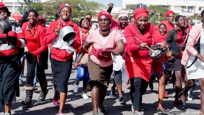 Women supporters of the MDC beating pots and pans
