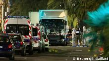 14.07.2016 French police forces and forensic officers stand next to a truck July 15, 2016 that ran into a crowd celebrating the Bastille Day national holiday on the Promenade des Anglais killing at least 60 people in Nice, France, July 14. REUTERS/Eric Gaillard Copyright: Reuters/E. Gaillard