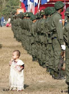 A young Karen child seems lost in a Karen Army formation Tuesday, Jan. 31, 2006, during Revolution Day ceremonies at their camp New Manerplaw, Myanmar.  The day marks the 57th anniversary of the Karen's break from the government in Yangon.  The 57 year armed resistance is one the longest running rebel insurgency in the world.  The Karen are an ethnic minority in Myanmar.  (AP Photo/David Longstreath)