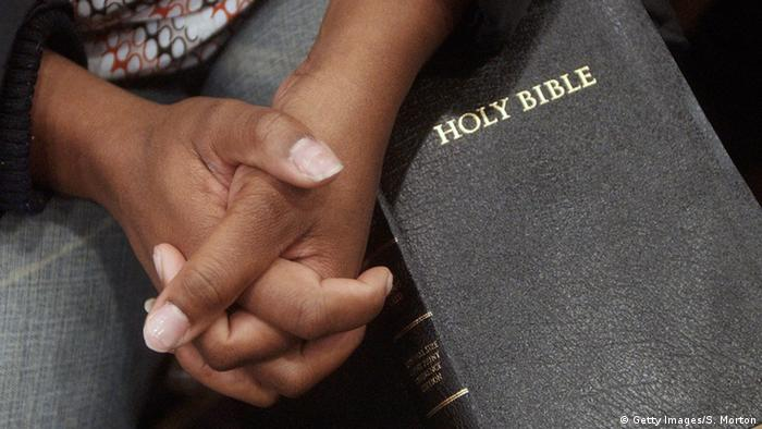 Hands on Bible (Getty Images/S. Morton)