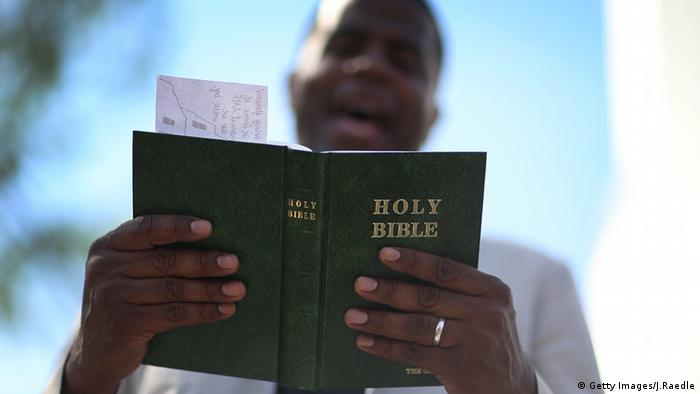 Pastor reading The Bible, Copyright: Getty Images/ J. Raedle