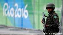Soldier of the Brazilian Armed Forces stands guard outside the 2016 Rio Olympics Park in Rio de Janeiro
