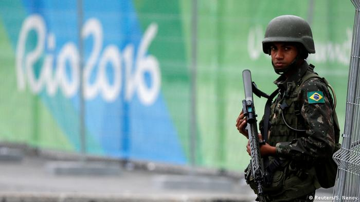 Soldier of the Brazilian Armed Forces stands guard outside the 2016 Rio Olympics Park in Rio de Janeiro (photo: Reuters/S. Nenov)