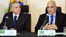 31.5.2016 *** Brazil's acting President Michel Temer (L) and Justice Minister Alexandre de Moraes are pictured during a meeting with the secretaries of security of Brazilian states, in Brasilia, on May 31, 2016. Temer proposed a 'joint effort' to 'ban' violence against women following two gang rapes of teenage girls including one in Rio de Janeiro supposedly involving 30 men that was filmed and posted online and that has shocked Brazil. / AFP / EVARISTO SA (Photo credit should read EVARISTO SA/AFP/Getty Images) Copyright: Getty Images/AFP/E. Sa