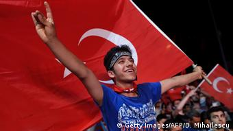An Erdogan supporter in Istanbul waves a Turkish flag