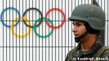 21.07.2016 A Brazilian military police soldier patrols at the security fence outside the 2016 Rio Olympics Park in Rio de Janeiro, Brazil, July 21, 2016. REUTERS/Fabrizio Bensch Copyright: Reuters/F. Bensch