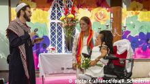 Lesbian couple Sahar Mosleh (wheelchair) and Maryam Iranfar (pregnant) got a blessing from gay imam Ludovic-Mohamed Zahed from South Africa at a wedding ceremony outside 7-Eleven at Humlegårdsgatan in central Stockholm, Sweden, during Pride Stockholm 2014. 2014-08-01 (c) Roger Schederin | picture-alliance/dpa/R.Schederin