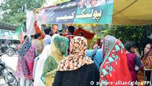 July 21, 2016 - Pakistan - RAWALPINDI, PAKISTAN, JUL 21: Voters check their names in voter list for casting their .votes at a polling camp during elections for seats of the Azad Jammu and Kashmir (AJK) .Legislative Assembly reserved for Kashmiri held in Rawalpindi on Thursday, July 21, 2016 |
