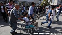23.07.2016 Afghans help an injured man at a hospital after an explosion struck a protest march, in Kabul, Afghanistan, Saturday, July 23, 2016. Witnesses in Kabul say that an explosion struck the protest march by members of Afghanistan?s largely Shiite Hazara ethnic minority group, demanding that a major regional electric power line be routed through their impoverished home province. (AP Photo/Rahmat Gul) | Copyright: picture-alliance/AP Photo/R. Gul