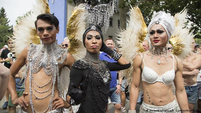Revelers pose during the CSD parade in Berlin