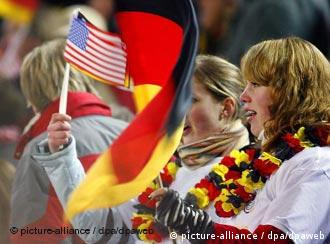 Soccer fans waiving German and US flags