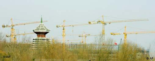 Cranes work in Beijing next to traditional Chinese pagoda