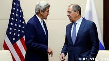 US Secretary of State John Kerry talks with Russian Foreign Minister Sergei Lavrov.