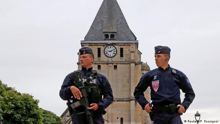 French CRS police stand guard in front of the church a day after a hostage-taking in Saint-Etienne-du-Rouvray near Rouen Copyright: Reuters/P. Rossignol
