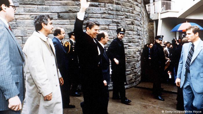 Ronald Reagan waves to onlookers moment before John Hinckley attempted to assassinate him in from of the Washington Hilton in DC