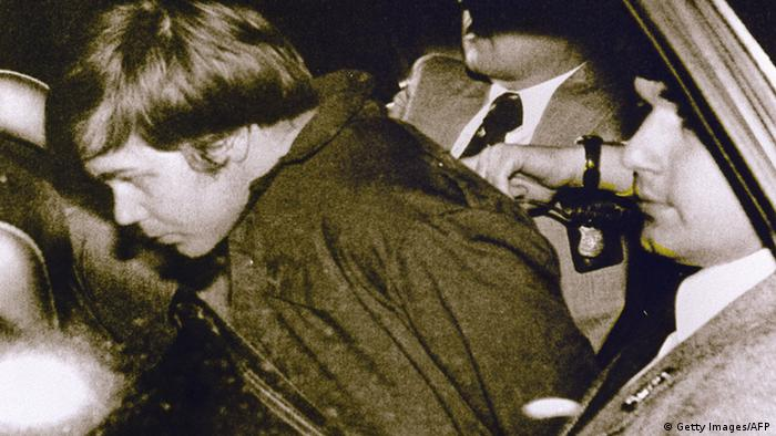John Hinckley Jr. (L) escorted by police in Washington, DC, following his arrest after shooting and seriously wounding then US president Ronald Reagan