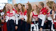 Russian Olympic team members attend a farewell ceremony for the Rio Games at Moscow's Sheremetyevo airport on July 28, 2016. / AFP / ALEXANDER UTKIN (Photo credit should read ALEXANDER UTKIN/AFP/Getty Images) © Getty Images/AFP/A. Utkin