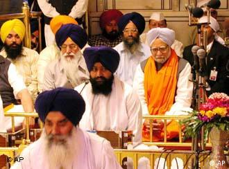 Indian Prime Minister Manmohan Singh, wearing an orange scarf, belongs to a religious minority: He is a Sikh