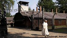 The cynical message on Auschwitz's gate translates as 'work sets you free'