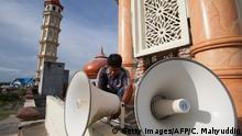 June 28, 2014*** An Acehnese worker inspects a loudspeaker at a mosque on the eve of the Islamic holy month Ramadan in Meulaboh town in Aceh province on June 28, 2014. During Ramadan the faithful are supposed to abstain from eating, drinking and sex from dawn until dusk. AFP PHOTO / CHAIDEER MAHYUDDIN (Photo credit should read CHAIDEER MAHYUDDIN/AFP/Getty Images) Getty Images/AFP/C. Mahyuddin