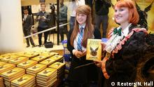 30.07.2016 Competition winner Fran Plagge (R) is the first to receive a copy of the book of the play of Harry Potter and the Cursed Child parts One and Two at a bookstore in London, Britain July Copyright: Reuters/N. Hall