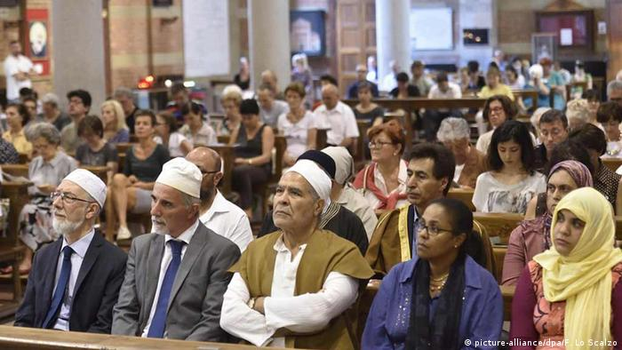 Members of Italy's Muslim community attend a multifaith service at Milan's Santa Maria Caravaggio church