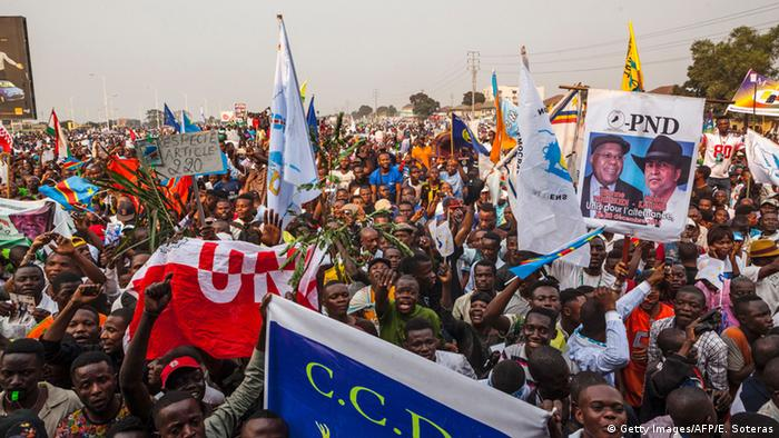 Opposition supporters hold up posters of Moise Katumbi and Etienne Tshisekedi in July 2016
