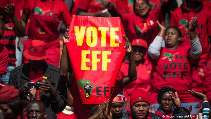 EFF supporters in red holding up a vote EFF banner