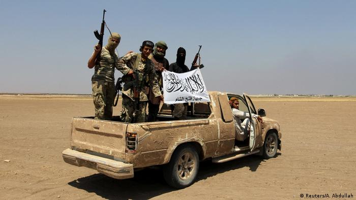 Бойцы повстанческой группировки Джебхат Фатах аш-Шам