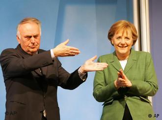 German Chancellor Angela Merkel and Saxony Anhalt premier Wolfgang Boehmer