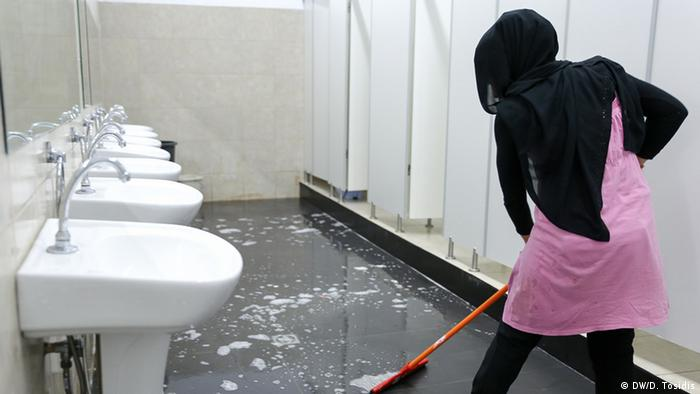 woman cleaning toilet copyright: Dimitris Tosidis