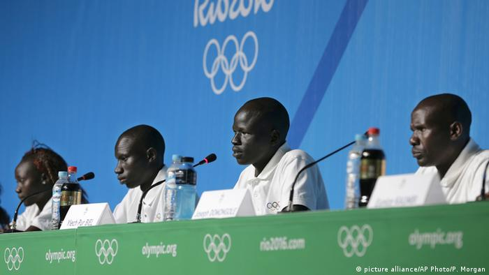 The refugee team at a press conference