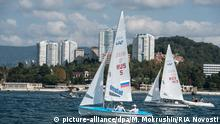 2503356 10/04/2014 From left: Athletes Pavel Sozykin and Denis Gribanov, Boris Kucherenko and Alexander Moskvichev during the class 470 yacht competition held as part of the Russian Regatta Championship in Sochi. Mihail Mokrushin/RIA Novosti | © picture-alliance/dpa/M. Mokrushin/RIA Novosti