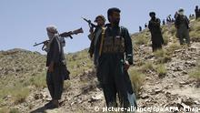 27.05.2016 Symbolbild In this Friday, May 27, 2016 photo, Taliban fighters stand guard as senior leader of a breakaway faction of the Taliban Mullah Abdul Manan Niazi, not pictured, delivers a speech to his fighters, in Shindand district of Herat province, Afghanistan. In the rugged terrain of the Taliban heartland in southern Afghanistan, the fight against Kabul has become a war for control of key stretches of main roads and highways as the insurgents use a new tactic to gain ground. (AP Photos/Allauddin Khan)   (c) picture-alliance/dpa/AP/A. Khan