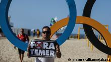 RIO DE JANERIO, BRAZIL - AUGUST 5: People stage a protest against Brazil's interim President Michel Temer near the Olympics Rings at the Copacabana beach ahead of the start of the Rio 2016 Olympic and Paralympic Games in Rio de Janerio, Brazil on August 5, 2016. Salih Zeki Fazlioglu / Anadolu Agency | Copyright: picture-alliance/abaca