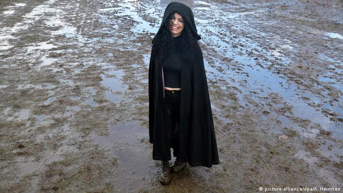 person standing in mud and rain