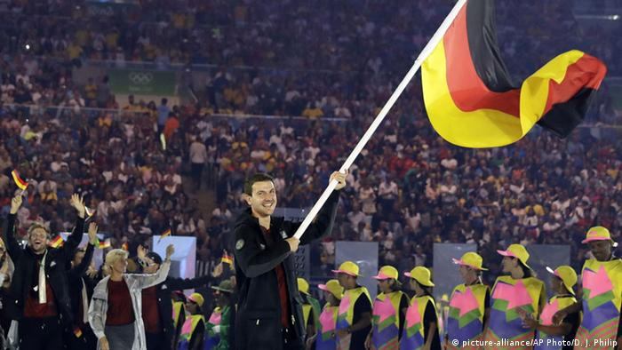 Timo Boll carrying flag