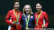 Gold medalist Virginia Thrasher from the USA is flanked by Silver medalist Li Du and Bronze medalist Siling Yi (r) both from China during the medal ceremony after the Olympic 10m Air Rifle 10m Women's finals in the Olympic Shooting Centre in Deodoro, Rio de Janeiro, Brazil, 06 August 2016. Photo: Friso Gentsch/dpa +++(c) dpa - Bildfunk+++   Verwendung weltweit