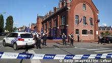 6.08.2016 Police stand as they secure the area around a police building in the southern Belgian city of Charleroi following a machete attack on August 6, 2016. Two policewomen were wounded in Charleroi by a machete-wielding man who shouted Allahu akbar (God is the greatest), local police said. The attacker was shot and injured, they said on Twitter. / AFP / BELGA / VIRGINIE LEFOUR / Belgium OUT (Photo credit should read VIRGINIE LEFOUR/AFP/Getty Images) Copyright: Getty Images/AFP/V. Lefour