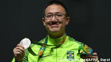 Brazil's silver medallist Felipe Almeida Wu poses on the podium during the medal ceremony for the men's 10m air pistol shooting event at the Rio 2016 Olympic Games at the Olympic Shooting Centre in Rio de Janeiro on August 6, 2016. / AFP / Pascal GUYOT (Photo credit should read PASCAL GUYOT/AFP/Getty Images)