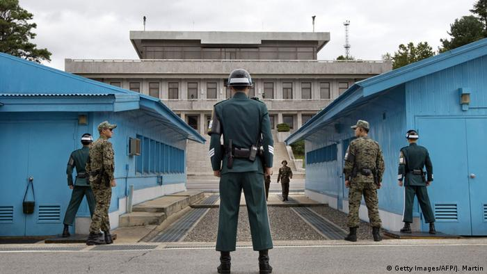 South Korean soldiers look toward the North Korean side