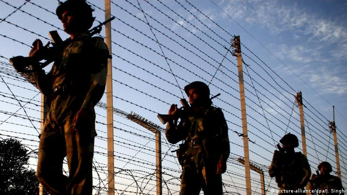 Indian soldiers patrol on the international border between India and Pakistan near the northern Indian city of Jammu