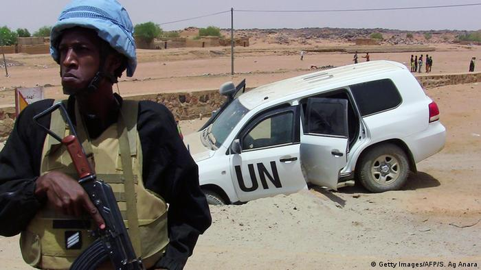 A soldier of the UN mission to Mali MINUSMA stands guard near a UN vehicle