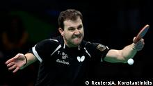 August 7, 2016*** 2016 Rio Olympics - Table Tennis - Men's Singles - Round 3 - Riocentro - Pavilion 3 - Rio de Janeiro, Brazil - 07/08/2016. Timo Boll (GER) of Germany plays against Alexander Shibaev (RUS) of Russia. REUTERS/Alkis Konstantinidis FOR EDITORIAL USE ONLY. NOT FOR SALE FOR MARKETING OR ADVERTISING CAMPAIGNS. Reuters/A. Konstantinidis