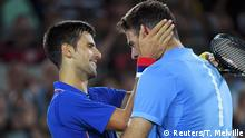 August 7, 2016*** 2016 Rio Olympics - Tennis - Preliminary - Men's Singles First Round - Olympic Tennis Centre - Rio de Janeiro, Brazil - 07/08/2016. Novak Djokovic (SRB) of Serbia reacts after losing his match against Juan Martin Del Potro (ARG) of Argentina. REUTERS/Toby Melville FOR EDITORIAL USE ONLY. NOT FOR SALE FOR MARKETING OR ADVERTISING CAMPAIGNS. Reuters/T. Melville