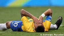 August 7, 2016*** 2016 Rio Olympics - Soccer - Preliminary - Men's First Round - Group A Brazil v Iraq - Mane Garrincha Stadium - Brasilia, Brazil 07/08/2016. Neymar (BRA) (R) of Brazil reacts after colliding with Alaa Ali (IRQ) of Iraq. REUTERS/Ueslei Marcelino FOR EDITORIAL USE ONLY. NOT FOR SALE FOR MARKETING OR ADVERTISING CAMPAIGNS. Reuters/U. Marcelino